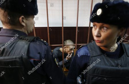 Russia's Political Performance Artist Pyotr Pavlensky (c) in a Cage at the Tagansky District Court in Moscow Russia 10 November 2015 a Criminal Case Has Been Opened Against Pavlensky who was Detained in Moscow After He Had Set Fire at the Door of Federal Security Service (fsb) Headquarters During His Action Under the Name of 'Threat' in the Early Hours of 09 November 2015 Russian Federation Moscow