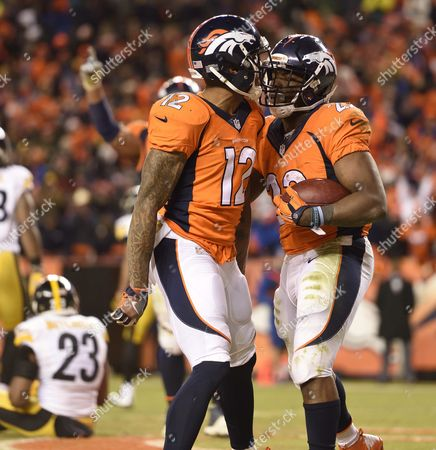 Denver Broncos Running Back Cj Anderson (r) Celebrates with Teammate Andre Caldwell After Anderson Scored the Go-ahead Touchdown Against the Pittsburgh Steelers in the Fourth Quarter of Their Afc Divisional Round Playoff at Sports Authority Field at Mile High in Denver Colorado Usa 17 January 2016 the Broncos Won the Game and Will Go on to Face the New England Patriots in the Afc Championship Game United States Denver