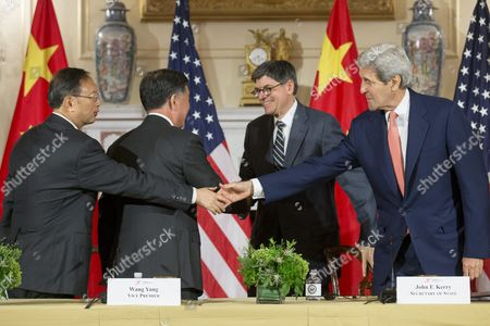 Us Secretary of State John Kerry (r) and Us Treasury Secretary Jack Lew (2-r) Shake Hands with State Councilor of China Yang Jiechi (l) and Vice Premier of China Wang Yang (2-l) at the Conclusion of the 2015 Us - China Strategic and Economic Dialogue (s and Ed) at the State Department in Washington Dc Usa 24 June 2015 the Annual Event is a Bilateral Forum where China and the Us Discuss a Broad Range of Issues Especially in the Area of Trade and the Global Economy United States Washington
