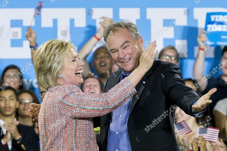 Us Democratic Presidential Candidate Hillary Clinton (l) and Democratic Senator From Virginia Tim Kaine (r) Gesture at a Campaign Event at Ernst Community Cultural Center at the Northern Virginia Community College's Annandale Campus in Annandale Virginia Usa 14 July 2016 United States Annandale
