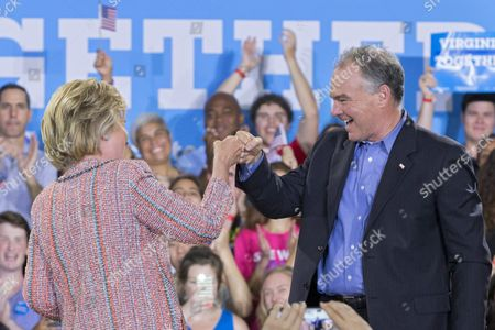 Us Democratic Presidential Candidate Hillary Clinton (l) Fist Bumps Democratic Senator From Virginia Tim Kaine (r) at a Campaign Event at Ernst Community Cultural Center at the Northern Virginia Community College's Annandale Campus in Annandale Virginia Usa 14 July 2016 United States Annandale