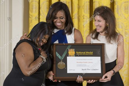 Us First Lady Michelle Obama (c) Stands with Community Member Kim Best (l) and Linda Johnson (r) President & Ceo Brooklyn Public Library; As They Accept the 2016 National Medal For Museum and Library Service During an Award Ceremony in the East Room of the White House in Washington Dc Usa 01 June 2016 Ten Institutions From Across the Country Received the Highest Award Given to Museums and Libraries For Service to the Community United States Washington