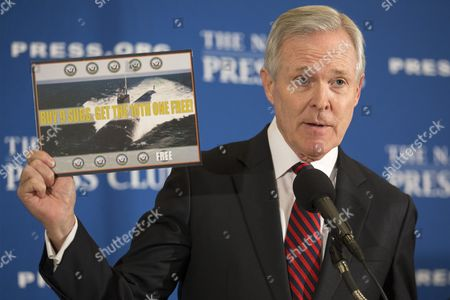 U S Navy Secretary Ray Mabus Holds Up a Picture of a Submarine That Reads 'Buy 9 Subs Get the 10th One Free' While Delivering Remarks on the Budget and Expansion of the Navy Fleet During a Luncheon Address at the National Press Club in Washington Dc Usa 12 October 2016 United States Washington