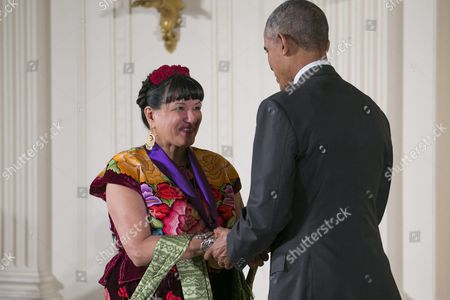 Us President Barack Obama (r) Awards Us Author Sandra Cisneros (l) with the 2015 National Medal of Arts During a Ceremony in the East Room of the White House in Washington Dc Usa 22 September 2016 Through Her Novels Short Stories and Poetry She Explores Issues of Race Class and Gender Through the Lives of Ordinary People Straddling Multiple Cultures As an Educator She Has Deepened Our Understanding of American Identity United States Washington