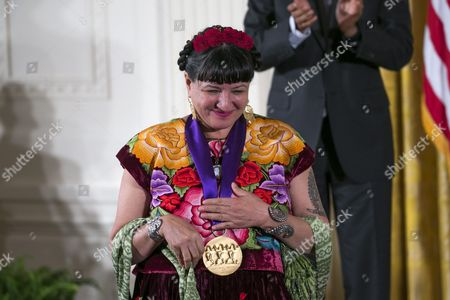 Us Author Sandra Cisneros Reacts After Receiving the 2015 National Medal of Arts During a Ceremony in the East Room of the White House in Washington Dc Usa 22 September 2016 Through Her Novels Short Stories and Poetry She Explores Issues of Race Class and Gender Through the Lives of Ordinary People Straddling Multiple Cultures As an Educator She Has Deepened Our Understanding of American Identity United States Washington