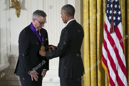 Us President Barack Obama (r) Awards Director and Playwright Moises Kaufman (l) with the 2015 National Medal of Arts During a Ceremony in the East Room of the White House in Washington Dc Usa 22 September 2016 Kaufman's Award-winning Tectonic Theater Project Continues to Move Audiences with Its Bold Portrayals of Contemporary Social Issues United States Washington