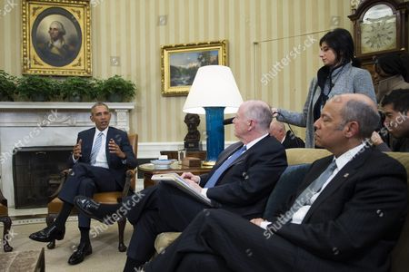 Stock Picture of Us President Barack Obama After Naming Former National Security Advisor Tom Donilon (c) and Former Ibm Ceo Sam Palmisano (r) Chair and Vice Chair Respectively to the Commission on Enhancing National Cybersecurity From the Oval Office in the White House in Washington Dc Usa 17 February 2016 United States Washington