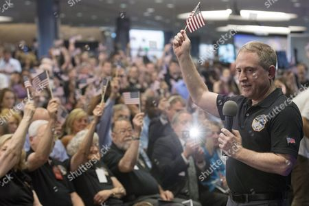 Alan Stern (r) Principal Investigator For New Horizons Participates in a Countdown to the New Horizons Spacecraft's Closest Proximity to Pluto at Johns Hopkins University Applied Physics Laboratory Site of the Mission Operations Center in Laurel Maryland Usa 14 July 2015 at Approximately 7:49 Am Et (11:49 Am Gmt) 14 July New Horizons was Scheduled to Be As Close to Pluto As the Spacecraft Will Get; About 7 800 Miles (12 500 Kilometers) Above the Surface Following a Journey of More Than Nine Years and Three Billion Miles This is the First Mission to the Pluto System and the Kuiper Belt United States Laurel