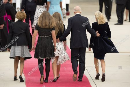 Us Vice President Joe Biden (2-r) and His Wife Jill Biden (r) Walk with Their Daughters and Mother-in-law of President Barack Obama Marian Shields Robinson (l) to Greet Pope Francis Before His Arrival at Joint Base Andrews Maryland Usa 22 September 2015 Pope Francis is on a Five-day Trip to the Usa Which Includes Stops in Washington Dc New York and Philadelphia After a Three-day Stay in Cuba Pope Francis Added the Cuba Visit After Helping Broker a Historic Rapprochement Between Washington and Havana That Ended a Diplomatic Freeze of More Than 50 Years United States Joint Base Andrews