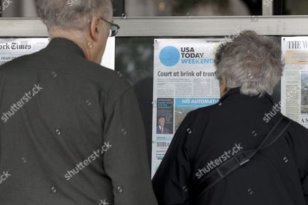 Peter Strauss (l) and Joanna Strauss (r) of New York City Look at the Front Page of the Weekend Edition of the Usa Today Which States That Republican Presidential Candidate Donald Trump is 'Unfit For the Presidency' According to the Newspaper's Editorial Board; on Display Outside the Newseum in Washington Dc Usa 30 September 2016 the Newspaper Has Made News by Declaring Trump 'Unfit For the Presidency' - the First Time the Publication's Editorial Board Has Publicly Taken a Side in a Us Presidential Race United States Washington
