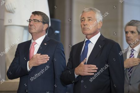 Former Secretary of Defense and Vietnam War Veteran Chuck Hagel (r) and Us Secretary of Defense Ashton Carter (l) Hold Their Hands Over Their Hearts During the Playing of the National Anthem During a Ceremony Held to Commemorate the 50th Anniversary of the Vietnam War on Capitol Hill in Washington Dc Usa 08 July 2015 United States Washington