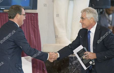 Former Secretary of Defense and Vietnam War Veteran Chuck Hagel (r) and Us Secretary of Defense Ashton Carter (l) Shake Hands During a Ceremony Held to Commemorate the 50th Anniversary of the Vietnam War on Capitol Hill in Washington Dc Usa 08 July 2015 United States Washington