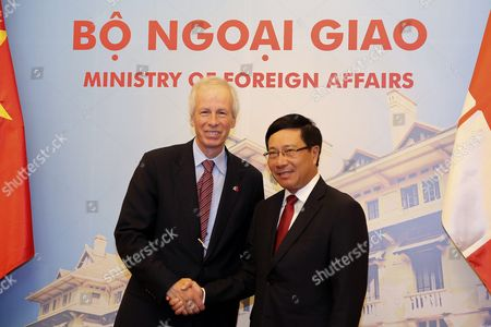 Canadian Foreign Minister Stephane Dion (l) and Vietnamese Foreign Minister Pham Binh Minh (r) Shake Hands at the Government Guesthouse in Hanoi Vietnam 05 September 2016 Dion is on an Official Visit to Vietnam From 03 to 08 September 2016 Viet Nam Hanoi