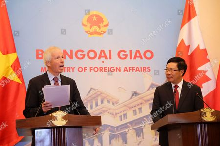 Canadian Foreign Minister Stephane Dion (l) Speaks While Vietnamese Foreign Minister Pham Binh Minh (r) Look on During a Press Briefing at the Government Guesthouse in Hanoi Vietnam 05 September 2016 Dion is on an Official Visit to Vietnam From 03 to 08 September 2016 Viet Nam Hanoi