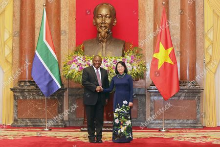 Deputy President of South Africa Cyril Ramaphosa (l) and His Vietnamese Counterpart Dang Thi Ngoc Thinh (r) Shake Hands As They Pose For the Media During Their Meeting at the Presidential Palace in Hanoi Vietnam 03 September 2016 Ramaphosa is on an Official Visit to Vietnam From 03 to 04 October 2016 Viet Nam Hanoi