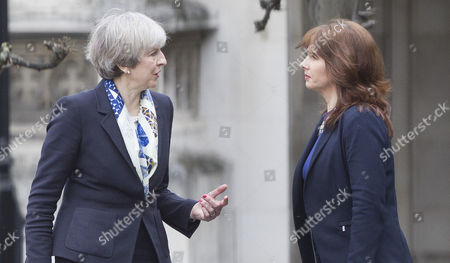 Prime Minister Theresa May (L) welcomes newly elected MP for Copeland Trudy Harrison to Parliament on her first day