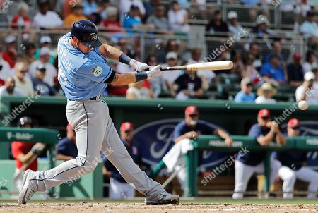 Tampa Bay Rays' Daniel Robertson grounds into a force out to score teammate Casey Gillaspie in the fifth inning of an exhibition spring training baseball game against the Boston Red Sox in Fort Myers, Fla., . Boston won 19-2