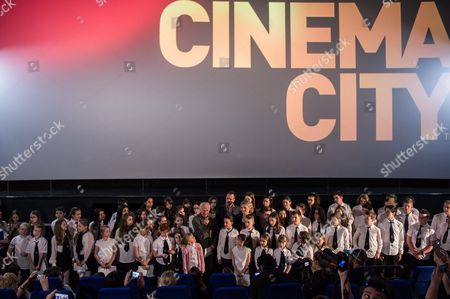 (C-L-R) Hungarian composer Arpad Balazs, his son, scorewriter Adam Balazs and choir's conductor Monika Molnar pose with choir members of Bakats Ter Primary and Music School, cast members of the Oscar-winning film 'Sing' (Mindenki) by Hungarian director Kristof Deak perform during the film's screening in Budapest, Hungary, 02 March 2017. Deak's film won in the best live-action short film category at the 89th Academy Awards on 26 February in Los Angeles.