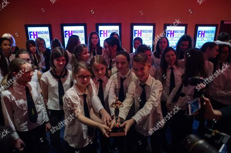 Members of Bakats Ter Primary and Music School Choir, cast members of the Oscar-winning film 'Sing' (Mindenki) by Hungarian director Kristof Deak hold a replica of the Oscar award statue during the film's screening in Budapest, Hungary, 02 March 2017. Deak's film won in the best live-action short film category at the 89th Academy Awards on 26 February in Los Angeles.