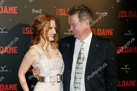 "Actress Jessica Chastain, left. and director John Madden attends a premiere of ""Miss Sloane"", in Paris"