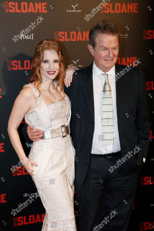 "Actress Jessica Chastain, left. and director John Madden attend a premiere of ""Miss Sloane"", in Paris"