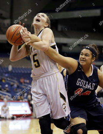 Stock Image of Haevyn Risley, Tessa Ross Canadian's Haevyn Risley (15) is fouled by Goliad's Tessa Ross (44) as she tries to score during a UIL Class 3A girls high school state semifinal basketball game, in San Antonio. Canadian won 76-34