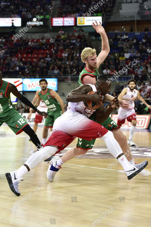 EA7 Emporio Armani's US player Rakim Sanders (L)in action against Chase Budinger (R) of Baskonia during their Euroleague basketball match played at the Fernando Buesa Arena pavillion in Vitoria, Basque Country, Spain, on 02 March 2017.