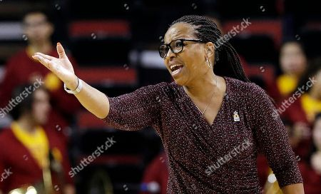 USC head coach Cynthia Cooper-Dyke directs her team against California in an NCAA college basketball game in the Pac-12 Conference tournament, in Seattle. California won 71-58