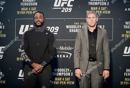Rashad Evans, left, and Daniel Kelly, of Australia, pose for photographers during a news conference for UFC 209, in Las Vegas. The two are scheduled to fight in a middleweight fight Saturday in Las Vegas