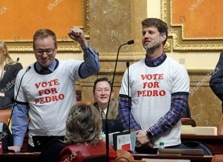 "Stock Picture of Jon Heder, Jeremy Peterson Actor and producer Jon Heder, right, stands next to Rep. Jeremy Peterson, R-Ogden, raising his fist in front of the Utah House of Representatives at the Utah State Capitol, in Salt Lake City. The star of 2004 hit movie ""Napoleon Dynamite"" is telling lawmakers that Utah's film tax incentives are vital to luring productions to the state"