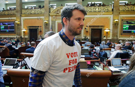 "Stock Image of Actor and producer Jon Heder leaves the Utah House floor after speaking with the representatives at the Utah State Capitol, in Salt Lake City. The star of 2004 hit movie ""Napoleon Dynamite"" is telling lawmakers that Utah's film tax incentives are vital to luring productions to the state. Heder spoke briefly to the state's legislature on Thursday about how the tax credits could help him bring movies to Utah. He wore a ""Vote For Pedro"" T-shirt in a nod to a memorable shirt worn by Heder in the film"
