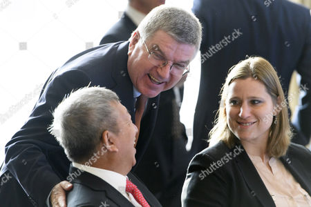 International Olympic Committee (ioc) President Thomas Bach Center From Germany Speakes with Ioc Members Angela Ruggiero Right of Us and Ser Miang Ng Left of Singapore at the Opening of the First Day of the Executive Board Meeting of the International Olympic Committee (ioc) in Lausanne Switzerland Tuesday December 6 2016 Switzerland Schweiz Suisse Lausanne