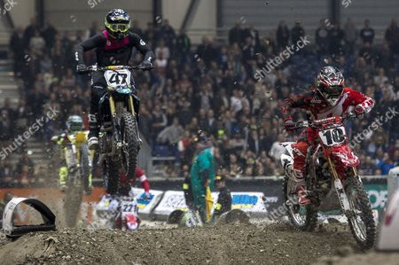 Stock Photo of Us Riders Malcolm Stewart (#47) and Justin Brayton (#10) Compete in a Sx1 Category Race During the 31th Geneva International Supercross at the Palexpo in Geneva Switzerland Late 02 December 2016 Switzerland Schweiz Suisse Geneva