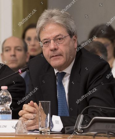 Italian Minister For Foreign Affairs Paolo Gentiloni Sits at 'Tavolo of Michelangelo Pistoletto' During a Press Conference For the Presentation of the Event 'Farnesina Porte Aperte on Dialogue Culture and Mediterranean' at Farnesina Palace in Rome Italy 28 November 2016 Italy Rome