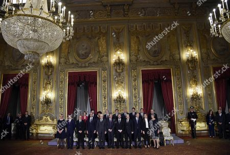The Members of the New Cabinet Line Up For a Group Photo at Quirinale Palace in Rome Italy 12 December 2016 First Row (l-r) Defense Minister Roberta Pinotti Justice Minister Andrea Orlando Interior Minister Marco Minniti Foreign Minister Angelino Alfano Italian President Sergio Mattarella Italian Prime Minister Paolo Gentiloni Sport Minister Luca Lotti Territorial Cohesion Minister Claudio De Vincenti Regional Affairs Minister Enrico Costa Public Administration Minister Marianna Madia Relations with Parliament Minister Anna Finocchiaro; Second Row (l-r) Health Minister Beatrice Lorenzin Cultural Heritage Minister Dario Franceschini Instruction Minister Valeria Fedeli Labour Minister Giuliano Poletti Infrastructure Minister Graziano Delrio Environment Minister Gianluca Galletti Agriculture Minister Maurizio Martina Economical Progress Minister Carlo Calenda and Economy Minister Pier Carlo Padoan President Mattarella on 11 December Gave the Former Foreign Minister a Mandate to Form a New Government in the Wake of Matteo Renzi's Resignation As Premier Following a Crushing Defeat in a 04 December Constitutional Referendum Italy Rome
