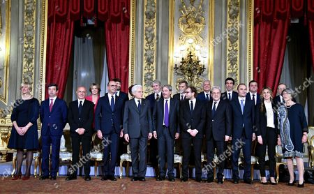 The Members of the New Cabinet Line Up For a Group Photo at Quirinale Palace in Rome Italy 12 December 2016 First Row (l-r) Defense Minister Roberta Pinotti Justice Minister Andrea Orlando Interior Minister Marco Minniti Foreign Minister Angelino Alfano Italian President Sergio Mattarella Italian Prime Minister Paolo Gentiloni Sport Minister Luca Lotti Territorial Cohesion Minister Claudio De Vincenti Regional Affairs Minister Enrico Costa Public Administration Minister Marianna Madia Relations with Parliament Minister Anna Finocchiaro; Second Row (l-r) Health Minister Beatrice Lorenzin Cultural Heritage Minister Dario Franceschini Instruction Minister Valeria Fedeli Labour Minister Giuliano Poletti Infrastructure Minister Graziano Delrio Environment Minister Gianluca Galletti Agriculture Minister Maurizio Martina Economical Progress Minister Carlo Calenda and Economy Minister Pier Carlo Padoan President Mattarella on 11 December Gave the Former Foreign Minister a Mandate to Form a New Government in the Wake of Matteo Renzi's Resignation As Premier Last Week Following a Crushing Defeat in a 04 December Constitutional Referendum Italy Rome