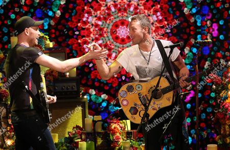 British Musicians Chris Martin (r) and Jonny Buckland (l) the Vocalist and the Lead Guitarist of the Rock Band Coldplay Perform During Their Live Appearance in the Italian Tv Program 'Che Tempo Che Fa' in Milan Italy 13 November 2016 Italy Milan