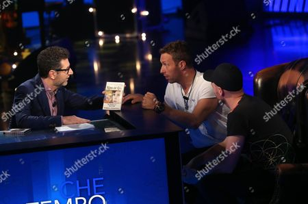 Italian Television Presenter Fabio Fazio (l) Speaks with British Musicians Chris Martin (c) and Jonny Buckland (r) the Vocalist and the Lead Guitarist of the Rock Band Coldplay During Their Live Appearance in the Italian Tv Program 'Che Tempo Che Fa' in Milan Italy 13 November 2016 Italy Milan