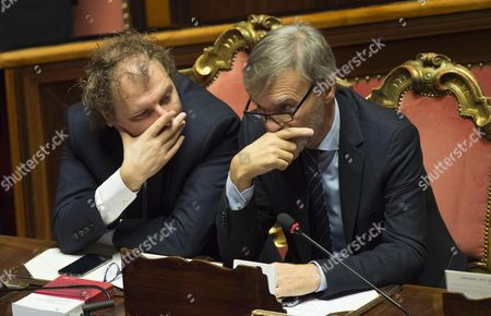 Italian Sport Minister Luca Lotti (l) Talks with Italian Minister of Infrastructure Graziano Delrio (r) at the Italian Senate Prior to a Vote of Confidence on Gentiloni's Government in Rome Italy 14 December 2016 the Upper House of the Italian Parliament is to Vote on Gentiloni's Government on 14 December One Day After the Lower House the Chamber of Deputies Had Confirmed Prime Minister Gentiloni in Their Voting by 368 (yes) Votes to 105 Votes Against Him Italy Rome