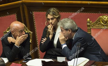 Italian Prime Minister Paolo Gentiloni (r) Talks with Italian Minister of Public Administration Marianna Madia (c) and Italian Interior Minister Marco Minniti (l) at the Italian Senate Prior to a Vote of Confidence on Gentiloni's Government in Rome Italy 14 December 2016 the Upper House of the Italian Parliament is to Vote on Gentiloni's Government on 14 December One Day After the Lower House the Chamber of Deputies Had Confirmed Prime Minister Gentiloni in Their Voting by 368 (yes) Votes to 105 Votes Against Him Italy Rome