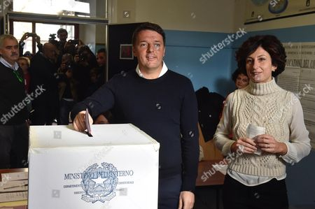 Italian Premier Matteo Renzi (l) and His Wife Agnese Renzi (r) Cast Their Ballots in a Polling Station During the Referendum on the Government's Constitutional Reform in Pontassieve Near Florence Italy 04 December 2016 the Crucial Referendum is Considered by the Government to End Gridlock and Make Passing Legislation Cheaper by Among Other Things Turning the Senate Into a Leaner Body Made Up of Regional Representatives with Fewer Lawmaking Powers It Would Also Do Away with the Equal Powers Between the Upper and Lower Houses of Parliament - an Unusual System That Has Been Blamed For Decades of Political Gridlock Italy Pontassieve