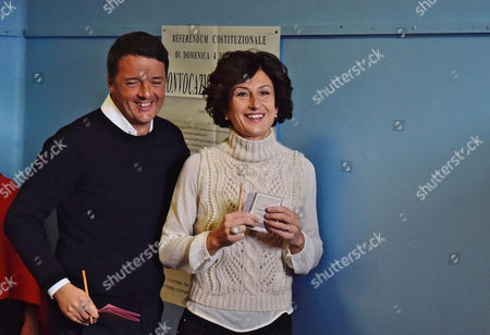 Epa05659308 Italian Premier Matteo Renzi (l) and His Wife Agnese Renzi (r) Arrive to a Polling Station During the Referendum on the Government's Constitutional Reform in Pontassieve Near Florence Italy 04 December 2016 the Crucial Referendum is Considered by the Government to End Gridlock and Make Passing Legislation Cheaper by Among Other Things Turning the Senate Into a Leaner Body Made Up of Regional Representatives with Fewer Lawmaking Powers It Would Also Do Away with the Equal Powers Between the Upper and Lower Houses of Parliament - an Unusual System That Has Been Blamed For Decades of Political Gridlock Epa/maurizio Degl' Innocenti Italy Pontassieve