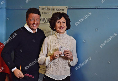 Italian Premier Matteo Renzi (l) and His Wife Agnese Renzi (r) Arrive to a Polling Station During the Referendum on the Government's Constitutional Reform in Pontassieve Near Florence Italy 04 December 2016 the Crucial Referendum is Considered by the Government to End Gridlock and Make Passing Legislation Cheaper by Among Other Things Turning the Senate Into a Leaner Body Made Up of Regional Representatives with Fewer Lawmaking Powers It Would Also Do Away with the Equal Powers Between the Upper and Lower Houses of Parliament - an Unusual System That Has Been Blamed For Decades of Political Gridlock Italy Pontassieve