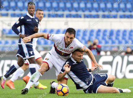 Lazio's Ciro Immobile (r) in Action Against Genoa's Nicolas Burdisso (c) During the Italian Serie a Soccer Match Between Ss Lazio and Genoa Cfc at Olimpico Stadium in Rome Italy 20 November 2016 Italy Rome