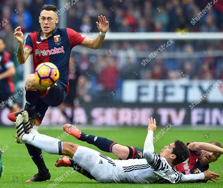 Juventus' Anderson Hernanes (c) in Action Against Genoa Players Lucas Ocampos (l) and Luca Rigoni (r) During the Italian Serie a Soccer Match Between Genoa Cfc and Juventus Fc at Luigi Ferraris Stadium in Genoa Italy 27 November 2016 Italy Genoa