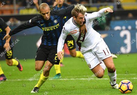 Inter's Joao Miranda (l) and Torino's Maxi Lopez in Action During the Italian Serie a Soccer Match Fc Inter Vs Torino Fc at Giuseppe Meazza Stadium in Milan Italy 26 October 2016 Italy Milan