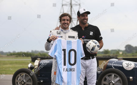 Spanish Formula One Driver Fernando Alonso (l) in a Vintage Bugatti Race Car Before a Race Against Argentinian Polo Player Facundo Pieres (unseen) on a Horse in Buenos Aires Argentina 09 November 2016 Argentina Buenos Aires