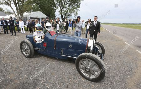 Stock Photo of Spanish Formula One Driver Fernando Alonso (l) in a Vintage Bugatti Race Car Before a Race Against Argentinian Polo Player Facundo Pieres (unseen) on a Horse in Buenos Aires Argentina 09 November 2016 Argentina Buenos Aires