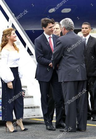 Stock Photo of Canada's Prime Minister Justin Trudeau (c) and His Wife Sophie Gregorie (l) Are Receive by Cuban Vice President Miguel Diaz-canel (r) Upon Their Arrival in Havana Cuba 15 November 2016 During Their Stay in the Island Trudeau Will Hold Official Talks with Cuban President Raul Castro and Will Offer a Conference at the University of the Capital Cuba Havana