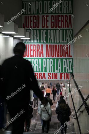 A Group of People Walk Pass by the Exhibition 'Empathy' by Us Artist Barbara Kruger in Mexico City Mexico 24 November 2016 the Exhibition Covers the Walls and Roof of the Bellas Artes Metro Station Mexico Mexico City
